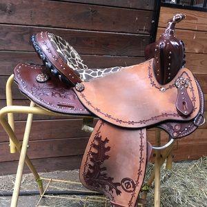 Diamond cross western barrel saddle